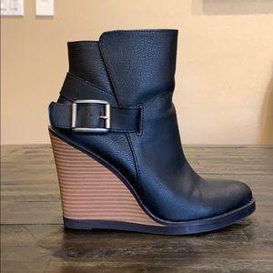 Black leather wedge booties